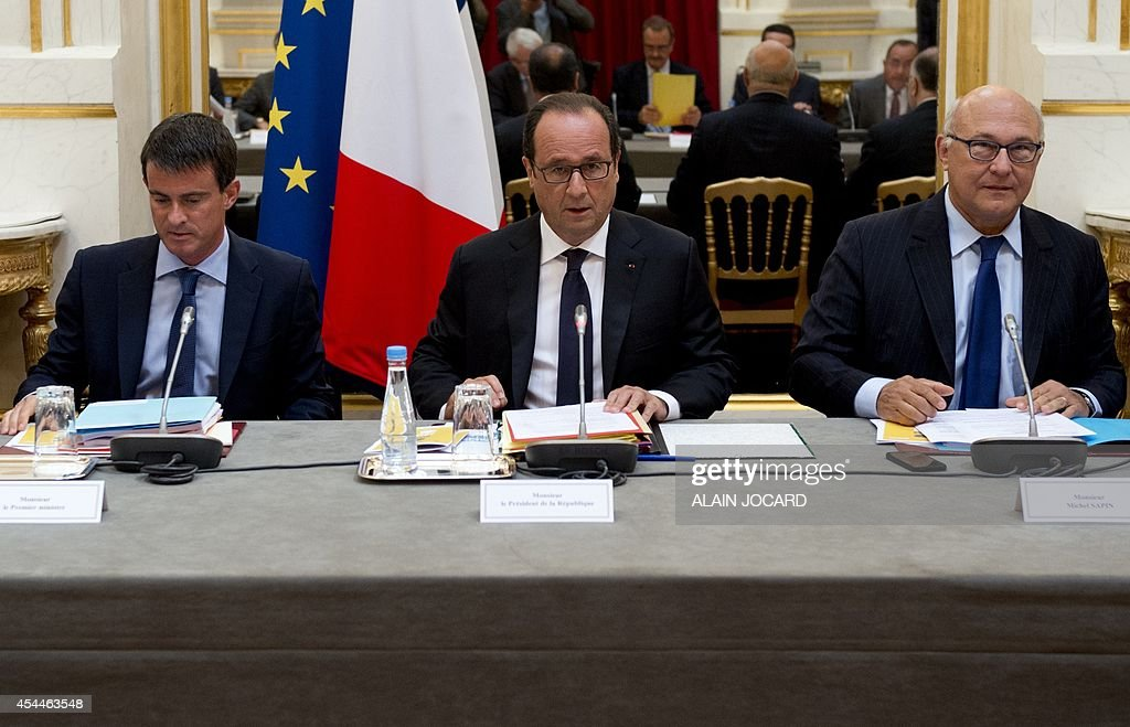 French Prime Minister Manuel Valls, French President Francois Hollande and French Finance minister Michel Sapin, take part in a meeting with regions prefects and regional administration managers on September 1, 2014, at the Elysee palace in Paris.