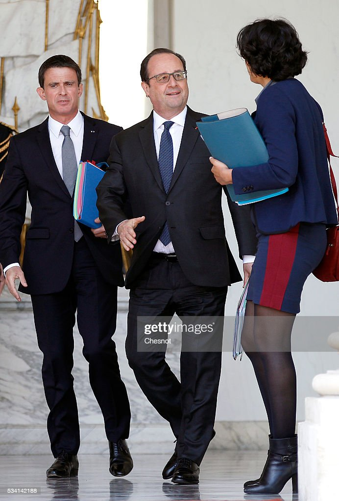 French Prime minister, <a gi-track='captionPersonalityLinkClicked' href=/galleries/search?phrase=Manuel+Valls&family=editorial&specificpeople=2178864 ng-click='$event.stopPropagation()'>Manuel Valls</a>, French President, Francois Hollande and <a gi-track='captionPersonalityLinkClicked' href=/galleries/search?phrase=Myriam+El+Khomri&family=editorial&specificpeople=9540474 ng-click='$event.stopPropagation()'>Myriam El Khomri</a>, French Labour Minister leave the Elysee Presidential Palace after a weekly cabinet meeting on May 25, 2016 in Paris, France. The French Government confirms that it tapped into its strategic reserves of petroleum products and said the equivalent of three days of inventory of 115 available had been used until now. the French government is facing a serious crisis following the El Khomri law.