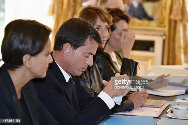 French Prime Minister Manuel Valls gestures as he attends flanked by French Education minister Najat VallaudBelkacem and French Social Affairs and...