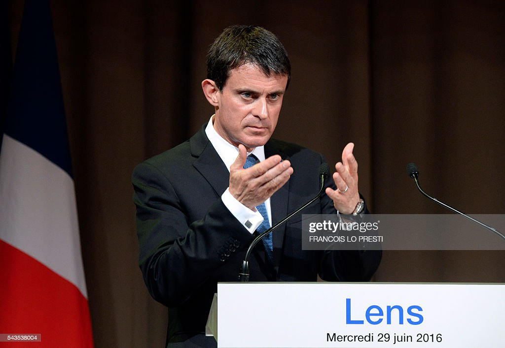 French Prime Minister Manuel Valls gestures as he delivers a speech at the Louvre-Lens museum in Lens, on June 29, 2016, as part of a visit dedicated to the rehabilitation of Lens-Lievin mining area and the surroundings, including the renovation of housing. French urban planner Jean-Louis Subileau is in charge of the project and is expected to report next fall. / AFP / FRANCOIS