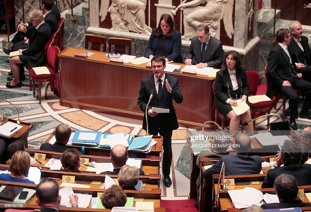French Prime Minister Manuel Valls gestures as he speaks at the French National Assembly in Paris on February 9, 2016, as French lawmakers examined proposed changes to the constitution. France's lower house of parliament is to vote on plans to enshrine a state of emergency into the constitution, including a controversial measure to strip French nationality from those convicted of terrorism and serious crimes. / AFP / JACQUES DEMARTHON