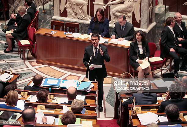 French Prime Minister Manuel Valls gestures as he speaks at the French National Assembly in Paris on February 9 as French lawmakers examined proposed...