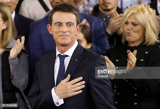 French Prime Minister Manuel Valls gestures at the end of a press conference where he announced that he is candidate for the 2017 presidential...