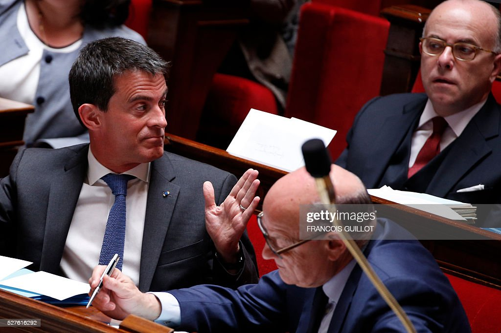 French Prime minister Manuel Valls (L) gestures eyed by French Interior minister Bernard Cazeneuve during a session of Questions to the government, on May 3, 2016 at the French National assembly in Paris.
