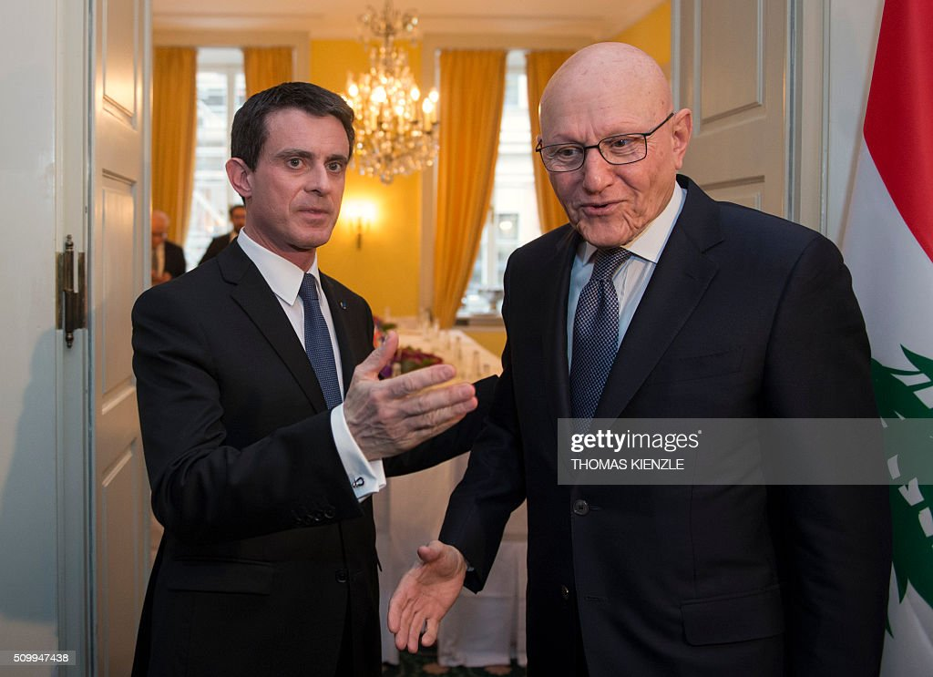 French Prime Minister Manuel Valls (L) greets Lebanese Prime Minister Tammam Salam as they meet for bilateral talks at the 52nd Munich Security Conference (MSC) in Munich, southern Germany, on February 13, 2016. / AFP / THOMAS KIENZLE