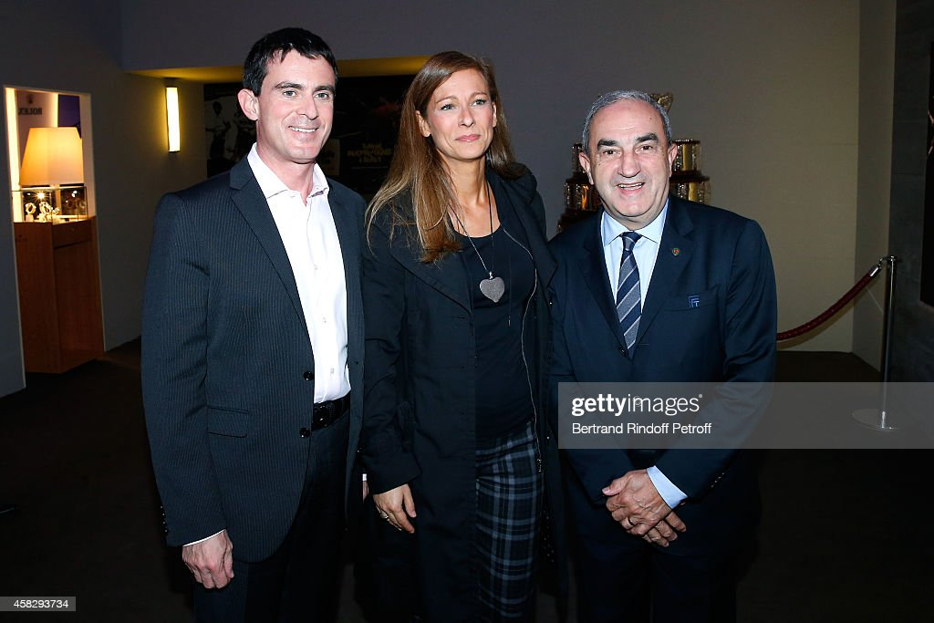 French Prime Minister Manuel Valls, his wife violonist Anne Gravoin and President of French Tennis Federation (FFT) Jean Gachassin attend the Final match during day 7 of the BNP Paribas Masters. Held at Palais Omnisports de Bercy on November 2, 2014 in Paris, France.