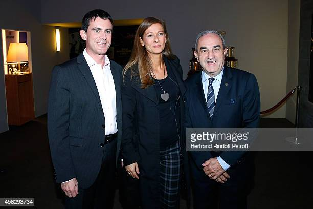 French Prime Minister Manuel Valls his wife violonist Anne Gravoin and President of French Tennis Federation Jean Gachassin attend the Final match...