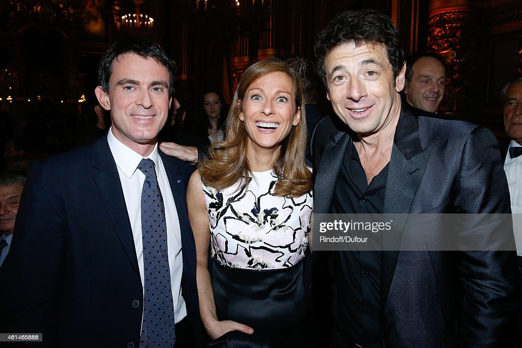 French Prime Minister Manuel Valls, his wife violonist Anne gravoin and singer Patrick Bruel attend Weizmann Institute celebrates its 40 Anniversary at Opera Garnier in Paris on January 12, 2015 in Paris, France.