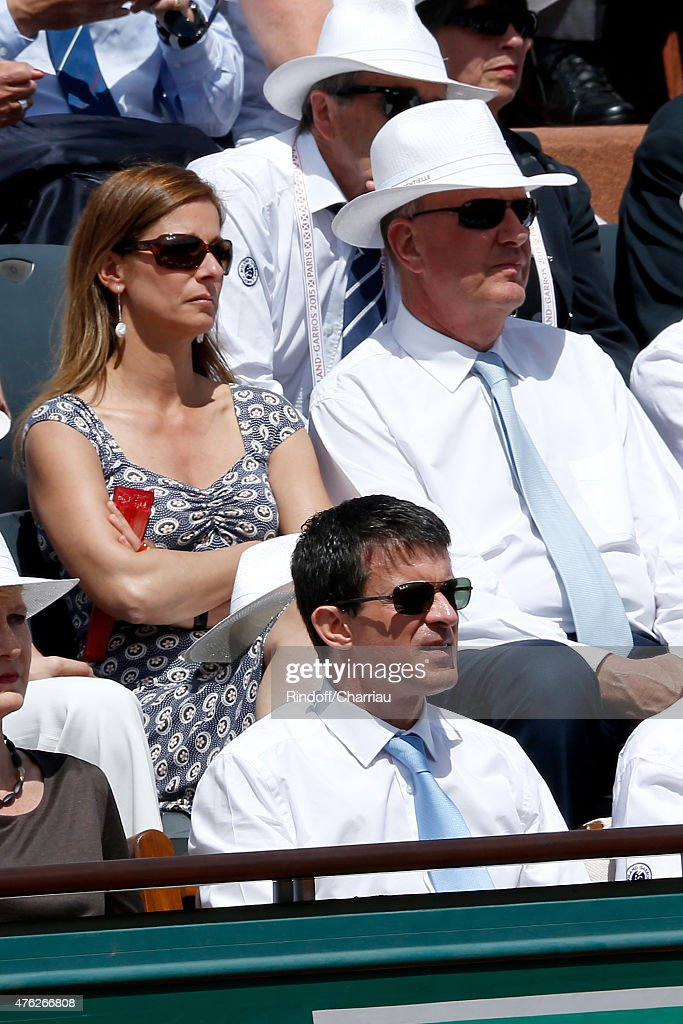French Prime Minister Manuel Valls, (2nd row L-R) his wife violonist Anne Gravoin and President of France Television Remy Pflimlin attend the Men Final of 2015 Roland Garros French Tennis Open - Day Fithteen, on June 7, 2015 in Paris, France