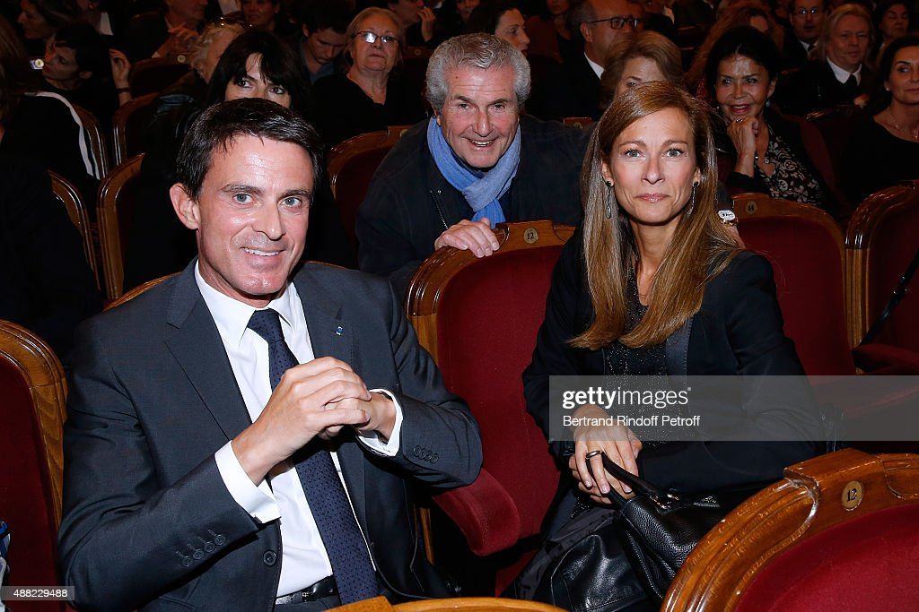 French Prime Minister Manuel Valls (L), his wife Violonist Anne Gravoin (R) and Director Claude Lelouche attend 'Le Mensonge' : Theater Play. Held at Theatre Edouard VII on September 14, 2015 in Paris, France.