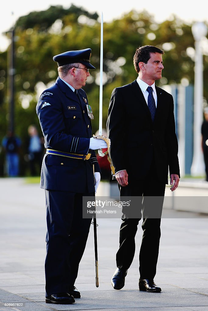 French Prime Minister Manuel Valls inspects the guard during a welcome ceremony at the Auckland museum on May 2, 2016 in Auckland, New Zealand. It is the first time in 25 years that a French Prime Minister has visited New Zealand.