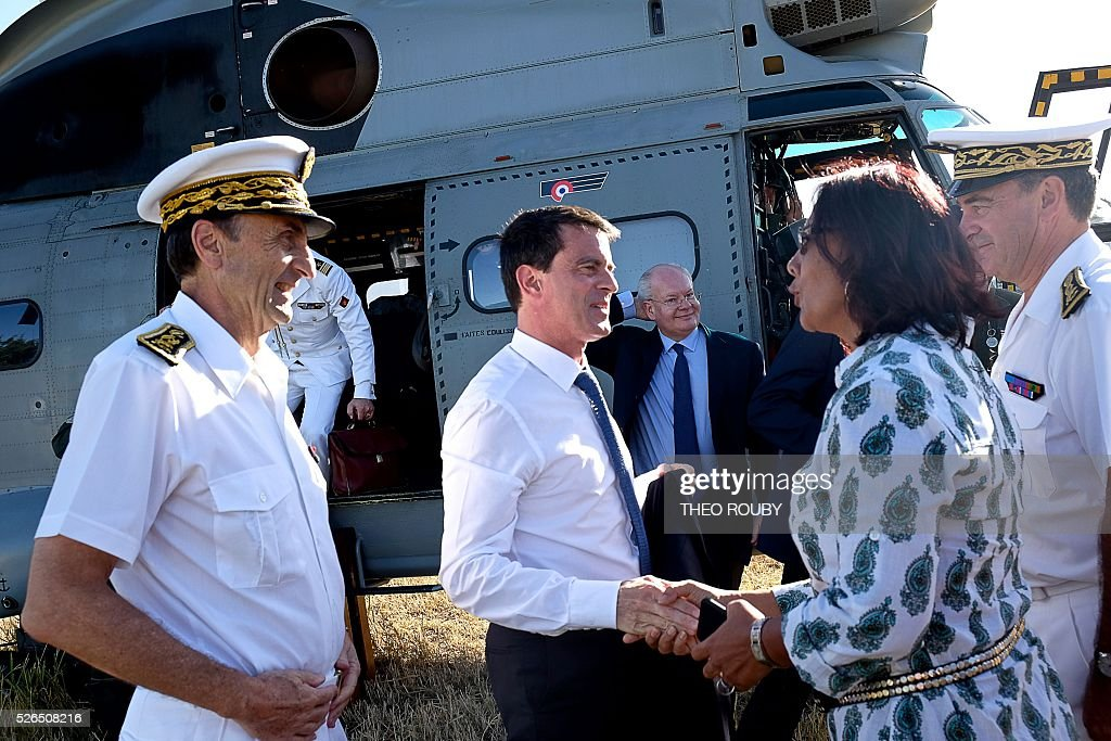 French Prime Minister Manuel Valls (C) is greeted by Mayor of La Foa Corine Voisin (2nd R), flanked by French Republic's High Commissioner in New Caledonia Vincent Bouvier (L) as he visits a farm on April 30, 2016 in La Foa, as part of his visit to the French Pacific territory of New Caledonia. / AFP / Th��o Rouby
