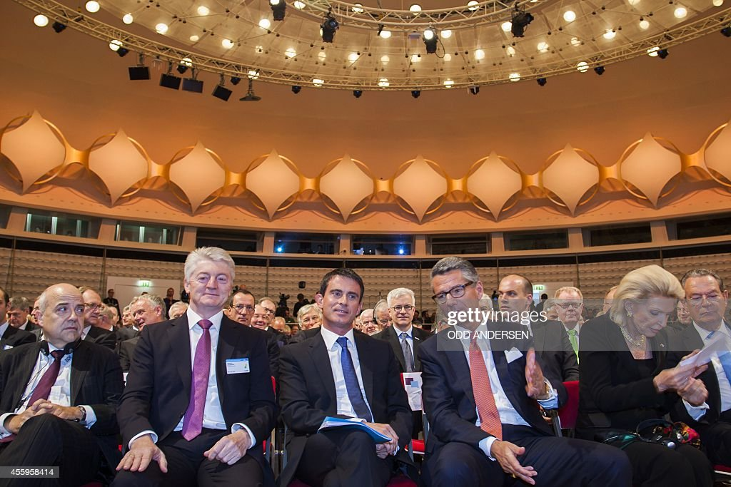 French Prime Minister Manuel Valls is seen seated next to President of the Federation of German Industries Ulrich Grillo CEO of Germany's industrial...