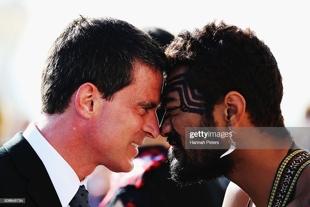French Prime Minister Manuel Valls is welcomed with a traditional Maori hongi by a Maori warrior at a welcome ceremony at the Auckland museum on May 2, 2016 in Auckland, New Zealand. It is the first time in 25 years that a French Prime Minister has visited New Zealand.