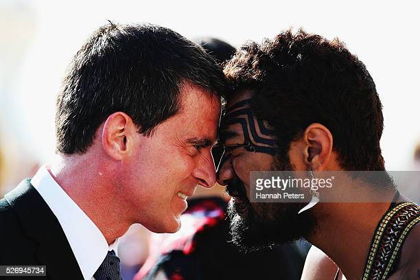 French Prime Minister Manuel Valls is welcomed with a traditional Maori hongi by a Maori warrior at a welcome ceremony at the Auckland museum on May...