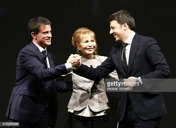 French Prime Minister Manuel Valls Italian journalist Lilli Gruber and Italian Prime Minister and Democratic Party leader Matteo Renzi pose on May 30...
