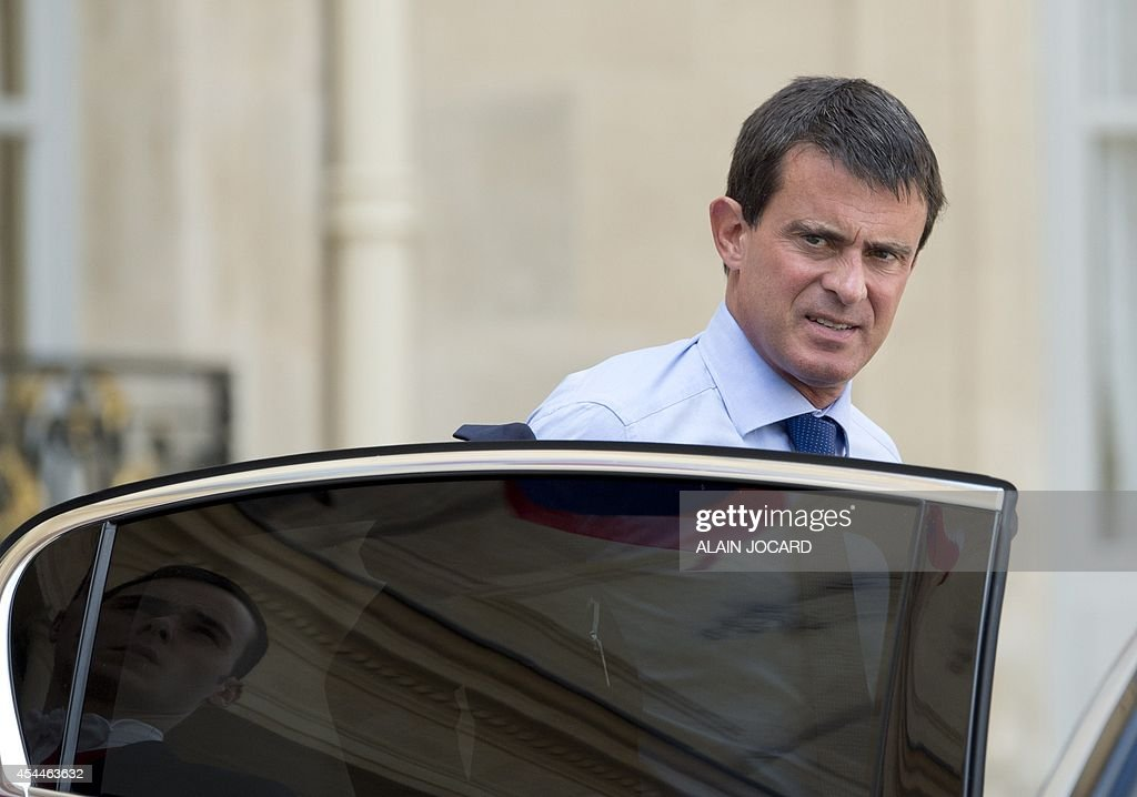 French Prime Minister Manuel Valls leaves after a meeting with regions prefects and regional administration managers on September 1, 2014, at the Elysee palace in Paris.