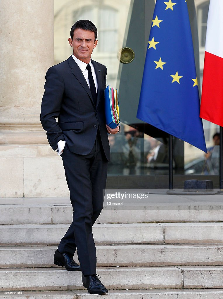 French Prime Minister <a gi-track='captionPersonalityLinkClicked' href=/galleries/search?phrase=Manuel+Valls&family=editorial&specificpeople=2178864 ng-click='$event.stopPropagation()'>Manuel Valls</a> leaves after the Cabinet Meeting at the Elysee Palace on September 23, 2015 in Paris, France.