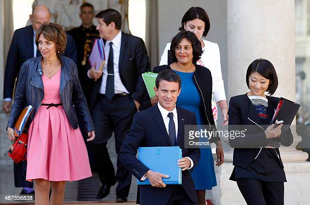 French Prime minister Manuel Valls leaves after the weekly cabinet meeting at the Elysee Presidential Palace on September 09 2015 in Paris France
