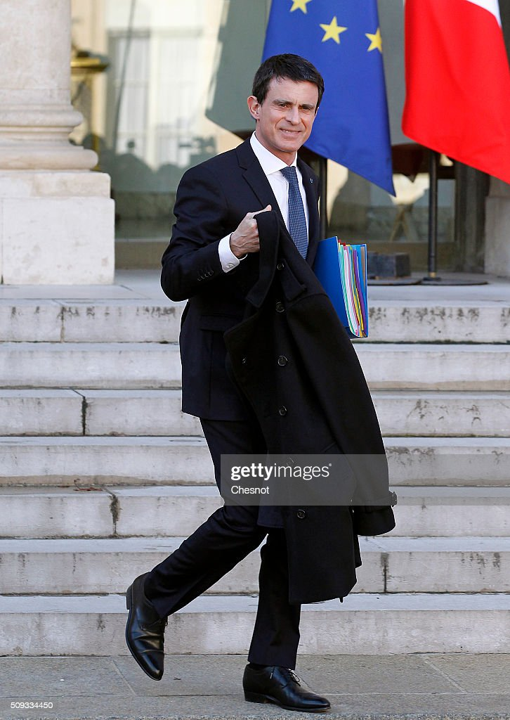 French Prime Minister <a gi-track='captionPersonalityLinkClicked' href=/galleries/search?phrase=Manuel+Valls&family=editorial&specificpeople=2178864 ng-click='$event.stopPropagation()'>Manuel Valls</a> leaves after the weekly cabinet meeting at the Elysee Palace on February 10, 2016 in Paris, France. This is the last cabinet meeting before the next ministerial reshuffle.