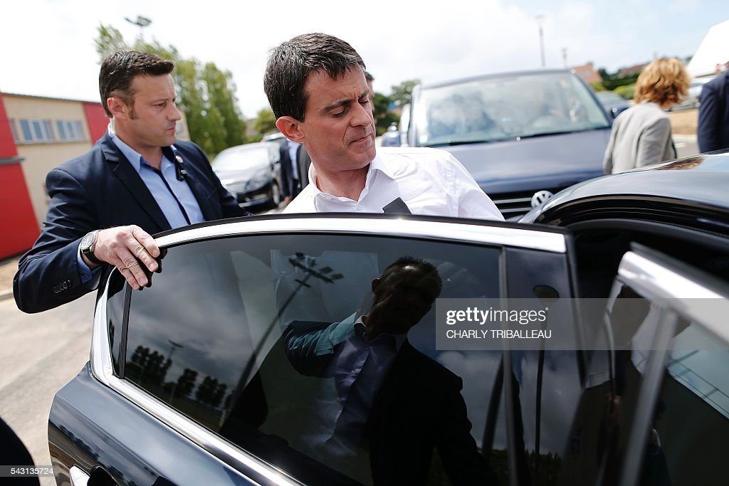 French Prime Minister Manuel Valls leaves the 'Banquet Republicain' on June 26, 2016 in Belleville-sur-Mer, northwestern France. French Prime Minister Manuel Valls on Sunday said he opposed the TTIP transatlantic trade treaty currently under negotiation on the grounds that it was against 'EU interests'. 'No free trade agreement should be concluded if it does not respect EU interests. Europe should be firm,' Valls told members of the governing Socialist Party, adding 'France will be vigilant about this.' / AFP / CHARLY