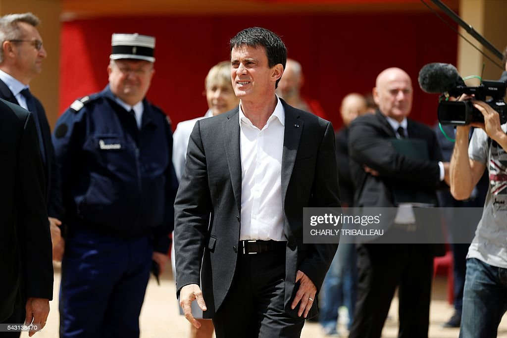 French Prime Minister Manuel Valls leaves the 'Banquet Republicain' on June 26, 2016 in Belleville-sur-Mer, northwestern France. Manuels Valls said on June 26, he opposed the TTIP transatlantic trade treaty currently under negotiation on the grounds that it was against 'EU interests'. 'No free trade agreement should be concluded if it does not respect EU interests. Europe should be firm,' Valls told members of the governing Socialist Party, adding 'France will be vigilant about this.' / AFP / CHARLY