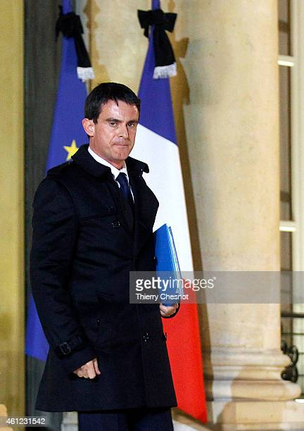 French Prime Minister Manuel Valls leaves the Elysee Palace after a crisis meeting at the Elysee Palace on January 9 in Paris France Both sieges in...
