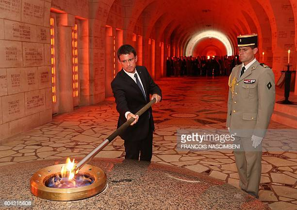 French Prime minister Manuel Valls lights the remembrance flame during a ceremony marking the 100th aniversary of the presentation to the city of the...