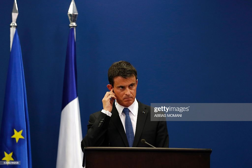 French Prime Minister Manuel Valls listens during a press conference with Palestinian prime minister in the West Bank city of Ramallah, on May 24, 2016. Palestinian prime minister Rami Hamdallah dismissed an Israeli proposal for direct negotiations instead of a French multilateral peace initiative, calling it an attempt to 'buy time'. / AFP / ABBAS