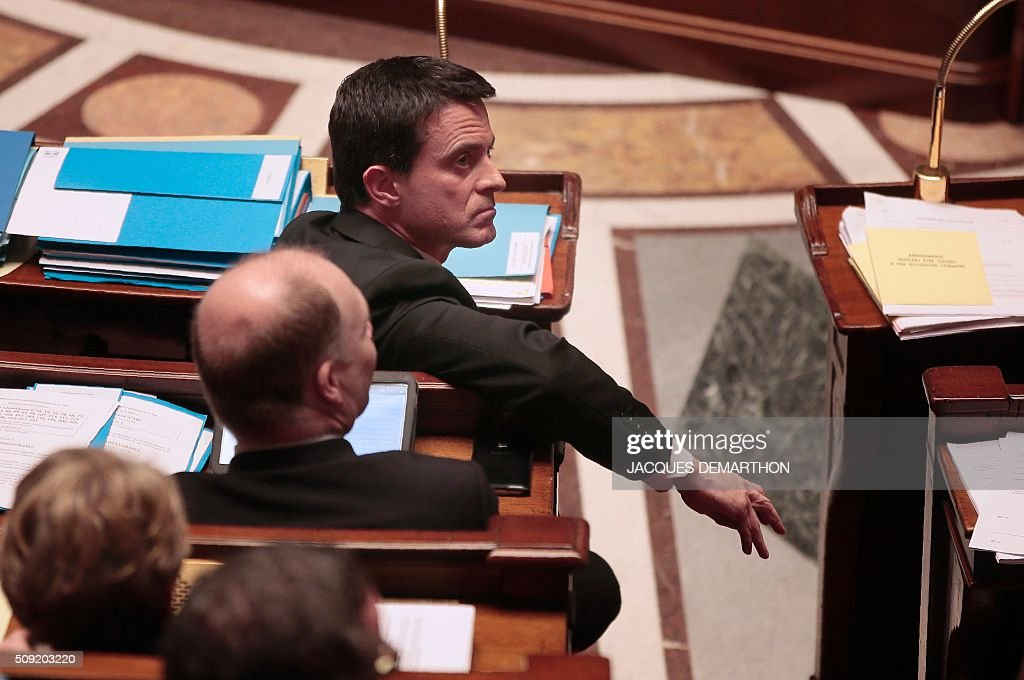 French Prime Minister Manuel Valls listens to the debate on Article 2, the controversial amendment to the constitution which would strip French nationality from those convicted of terrorism and serious crimes, at the French National Assembly in Paris on February 9, 2016. France's lower house of parliament is to vote on plans to enshrine a state of emergency into the constitution, including a controversial measure to strip French nationality from those convicted of terrorism and serious crimes. / AFP / JACQUES DEMARTHON