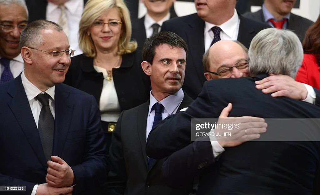 French Prime minister <a gi-track='captionPersonalityLinkClicked' href=/galleries/search?phrase=Manuel+Valls&family=editorial&specificpeople=2178864 ng-click='$event.stopPropagation()'>Manuel Valls</a> (C) looks at European Parliament President <a gi-track='captionPersonalityLinkClicked' href=/galleries/search?phrase=Martin+Schulz&family=editorial&specificpeople=598638 ng-click='$event.stopPropagation()'>Martin Schulz</a> (2nd R) hugging former Spanish Prime Minister <a gi-track='captionPersonalityLinkClicked' href=/galleries/search?phrase=Felipe+Gonzalez&family=editorial&specificpeople=6081940 ng-click='$event.stopPropagation()'>Felipe Gonzalez</a> (R) next to President of the Party of European Socialists (PES) Sergei Stanishev (L) as they pose for a family photo during the PES leaders meeting at IFEMA pavilion in Madrid, on February 21, 2015. The meeting, hosted by the Spanish Socialist Workers' Party (PSOE), gathers PES leaders, Prime Ministers and EU Commissioners who will discuss pivotal issues such as the fight against extremism and will make a joint declaration that will outline the PES roadmap for creating more and fairer jobs.