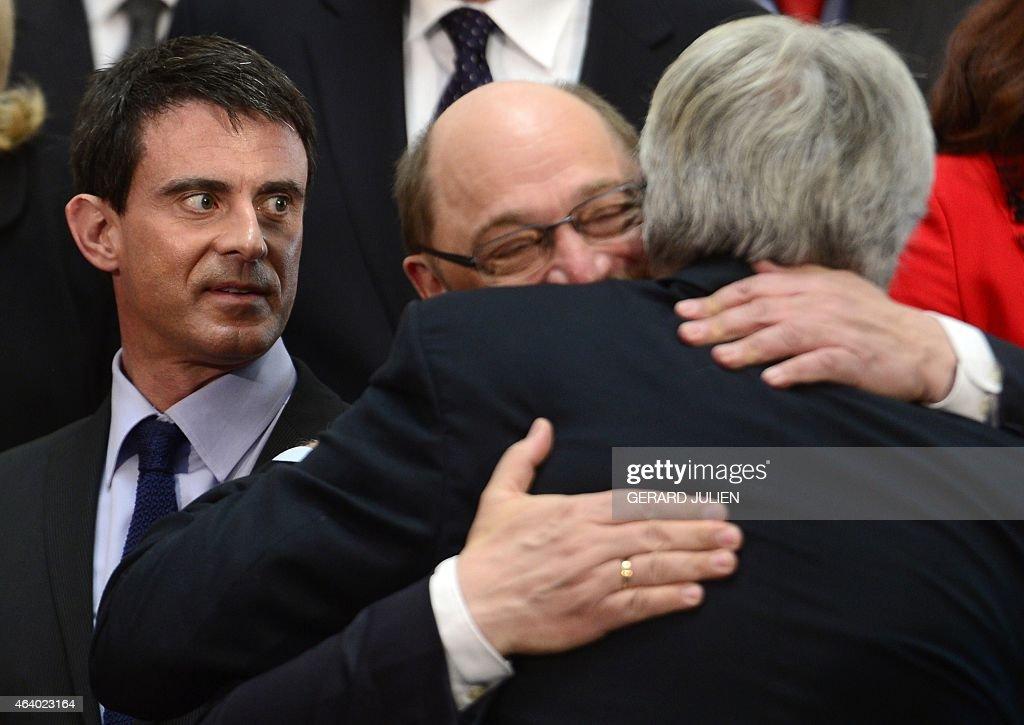 French Prime minister <a gi-track='captionPersonalityLinkClicked' href=/galleries/search?phrase=Manuel+Valls&family=editorial&specificpeople=2178864 ng-click='$event.stopPropagation()'>Manuel Valls</a> (C) looks at European Parliament President <a gi-track='captionPersonalityLinkClicked' href=/galleries/search?phrase=Martin+Schulz&family=editorial&specificpeople=598638 ng-click='$event.stopPropagation()'>Martin Schulz</a> (2nd R) hugging former Spanish Prime Minister <a gi-track='captionPersonalityLinkClicked' href=/galleries/search?phrase=Felipe+Gonzalez&family=editorial&specificpeople=6081940 ng-click='$event.stopPropagation()'>Felipe Gonzalez</a> (R) next to President of the Party of European Socialists (PES) Sergei Stanishev (L) as they pose for a family photo during the PES leaders meeting at IFEMA pavilion in Madrid, on February 21, 2015. The meeting, hosted by the Spanish Socialist Workers' Party (PSOE), gathers PES leaders, Prime Ministers and EU Commissioners who will discuss pivotal issues such as the fight against extremism. Jihadists in Libya pose a 'direct threat' to Europe, French Prime Minister <a gi-track='captionPersonalityLinkClicked' href=/galleries/search?phrase=Manuel+Valls&family=editorial&specificpeople=2178864 ng-click='$event.stopPropagation()'>Manuel Valls</a> said in Madrid today.