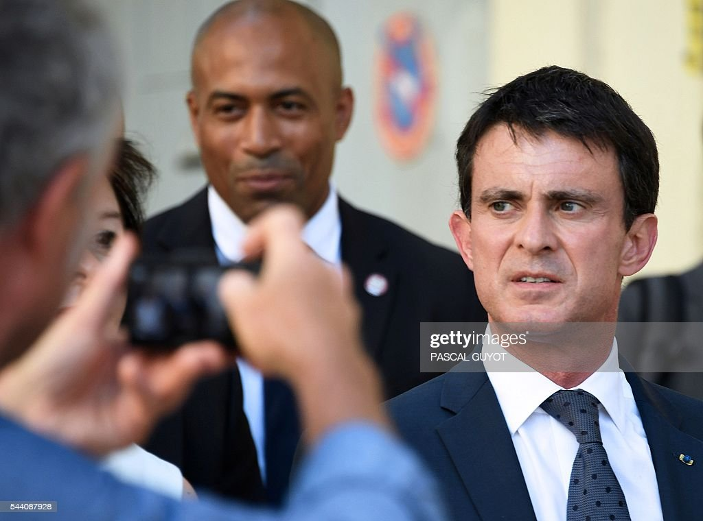French Prime Minister Manuel Valls looks on during a visit to Montpellier, southern France, on July 1, 2016. / AFP / PASCAL