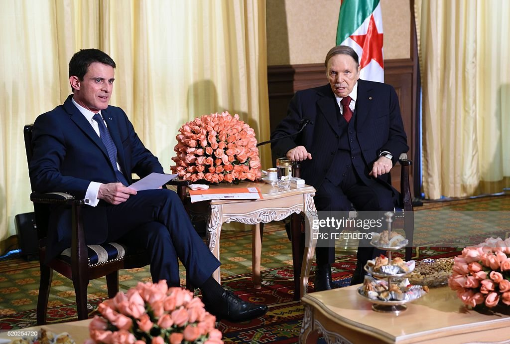 French Prime Minister Manuel Valls (L) meets Algerian President <a gi-track='captionPersonalityLinkClicked' href=/galleries/search?phrase=Abdelaziz+Bouteflika&family=editorial&specificpeople=176720 ng-click='$event.stopPropagation()'>Abdelaziz Bouteflika</a> at his residence during an official visit on April 10, 2016 in Zeralda, a suburb of the capital. / AFP / Eric FEFERBERG