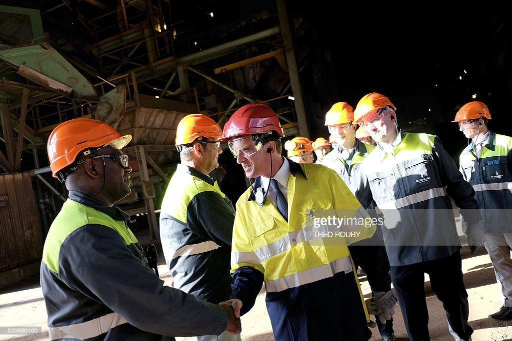 French Prime Minister Manuel Valls meets metallurgic factory SLN's workers during their visit in Noumea on April 29, 2016. Valls said France would be willing to loan 200 millions euros to save the SLN factory, the main producer of nickel in New Caledonia. / AFP / THEO