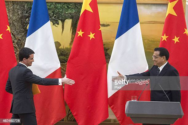 French Prime Minister Manuel Valls meets with his counterpart Li Keqiang during the signing of agreements at the Great Hall of the People on January...