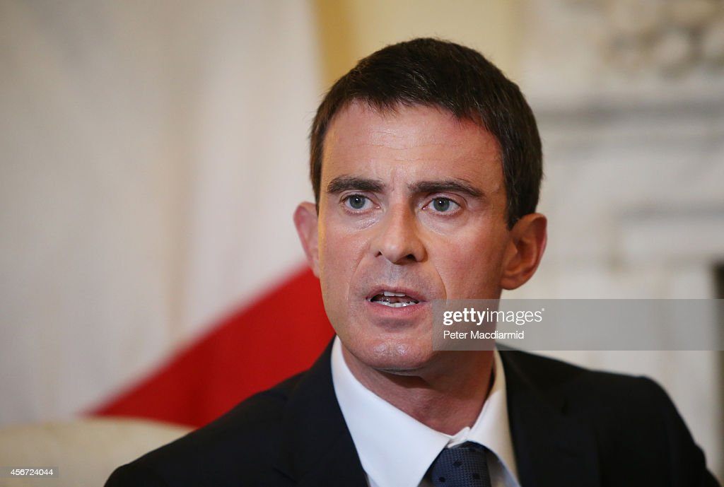 French Prime Minister <a gi-track='captionPersonalityLinkClicked' href=/galleries/search?phrase=Manuel+Valls&family=editorial&specificpeople=2178864 ng-click='$event.stopPropagation()'>Manuel Valls</a> meets with Prime Minister David Cameron (unseen) at 10 Downing Street on October 6, 2014 in London, England. M. Valls is on a two day visit to London.