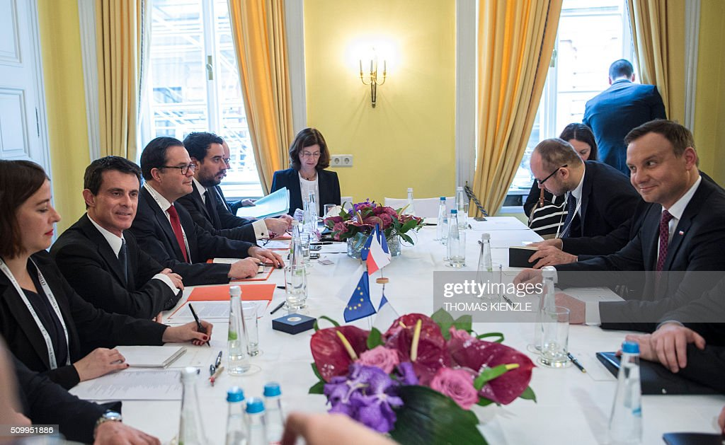 French Prime Minister Manuel Valls (2nd L), Polish President Andrzej Duda and their delegations have taken seat for bilateral talks at the 52nd Munich Security Conference (MSC) in Munich, southern Germany, on February 13, 2016. / AFP / THOMAS KIENZLE