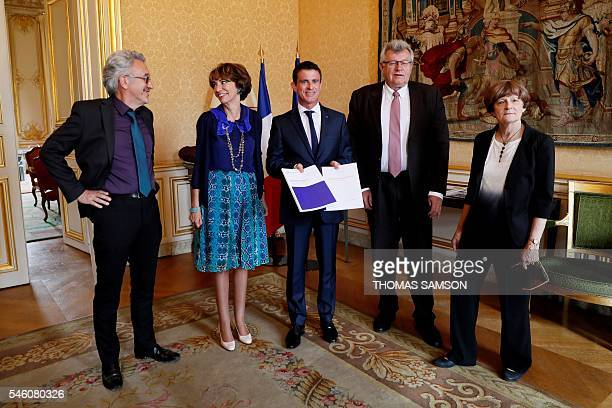 French Prime Minister Manuel Valls poses after receiving a report on French pension evolution next to PierreLouis Bras President of the 'Conseil...