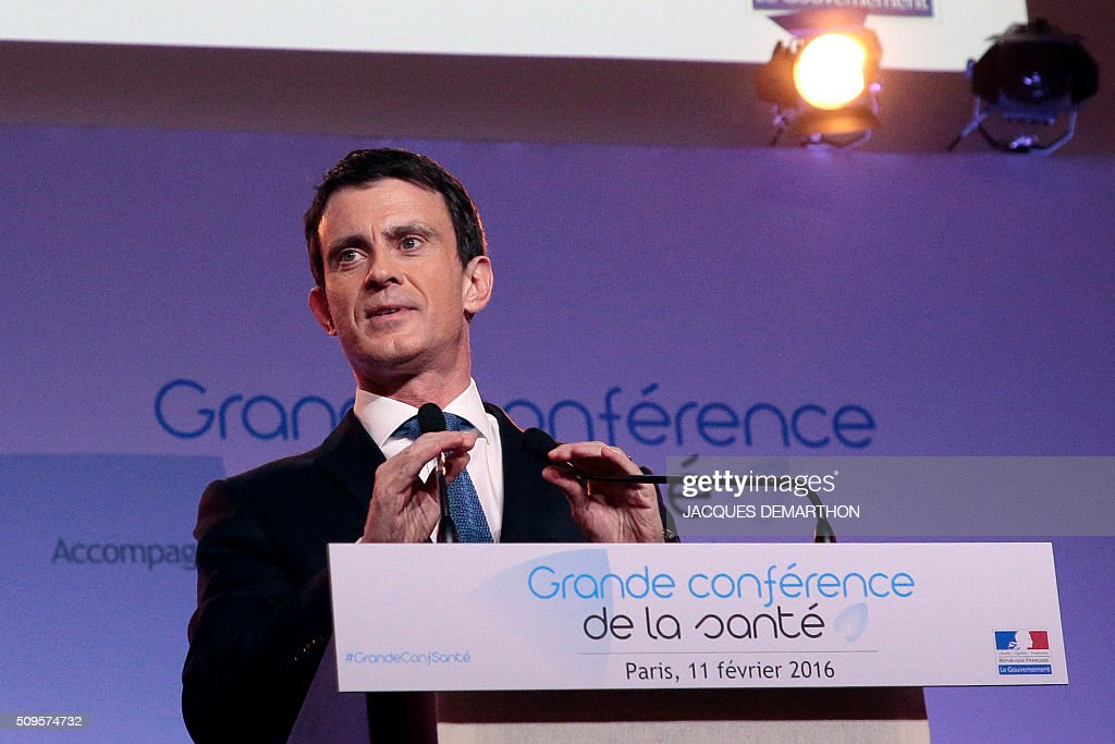 French Prime Minister Manuel Valls prepares to deliver his closing speech at the Health Conference organised by the government on February 11, 2016 in Paris. / AFP / JACQUES DEMARTHON