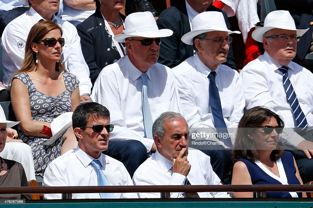 French Prime Minister Manuel Valls, President of French Tennis Federation Jean Gachassin, Mayor of Paris Anne Hidalgo, (2nd row, L-R) Miss valls, Violonist Anne Gravoin and President of France Television Remy Pflimlin attend the Men Final of 2015 Roland Garros French Tennis Open - Day Fithteen, on June 7, 2015 in Paris, France
