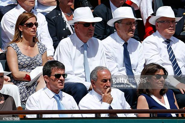 French Prime Minister Manuel Valls President of French Tennis Federation Jean Gachassin Mayor of Paris Anne Hidalgo Miss valls Violonist Anne Gravoin...