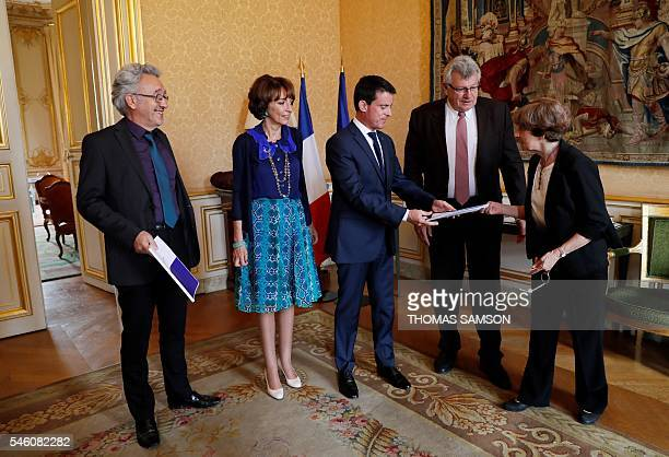 French Prime Minister Manuel Valls receives a report on French pension evolution from Yannick Moreau President of the 'Comite de suivi des retraites'...