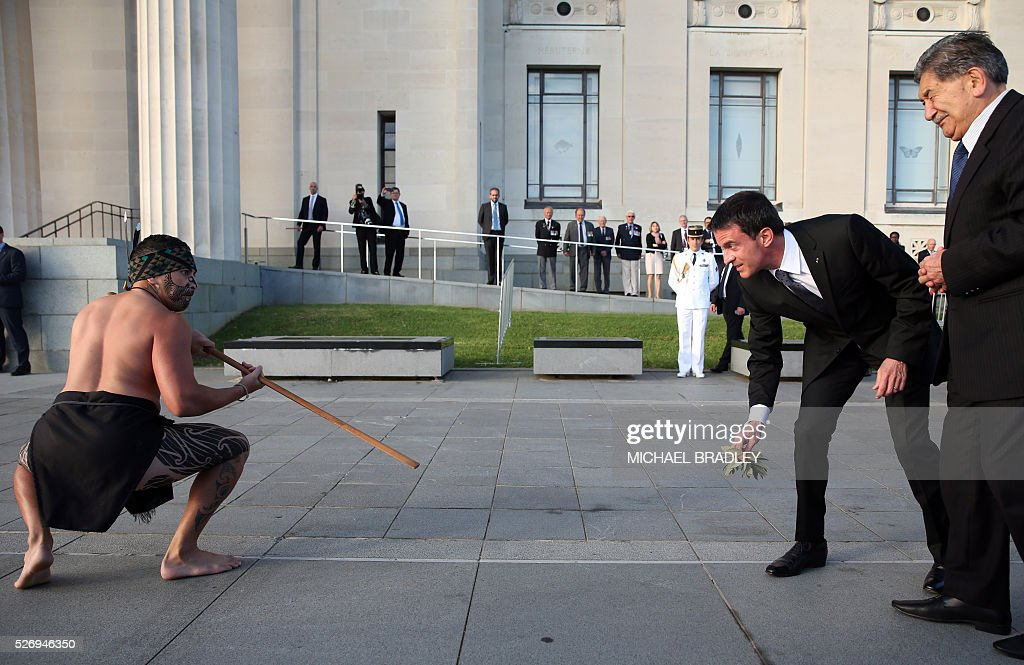 French Prime Minister Manuel Valls (2nd-R) receives an officail Maori welcome at the Auckland War Memorial Museum in Auckland on May 2, 2016. Valls arrived in New Zealand on May 1st after visiting the French Pacific territory of New Caledonia, with officials in his delegation confirming that he will detour to Australia later today. / AFP / MICHAEL