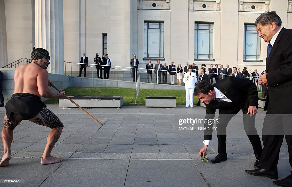 French Prime Minister Manuel Valls (2nd-R) recieves an officail Maori welcome at the Auckland War Memorial Museum in Auckland on May 2, 2016. Valls arrived in New Zealand on May 1st after visiting the French Pacific territory of New Caledonia, with officials in his delegation confirming that he will detour to Australia later today. / AFP / MICHAEL