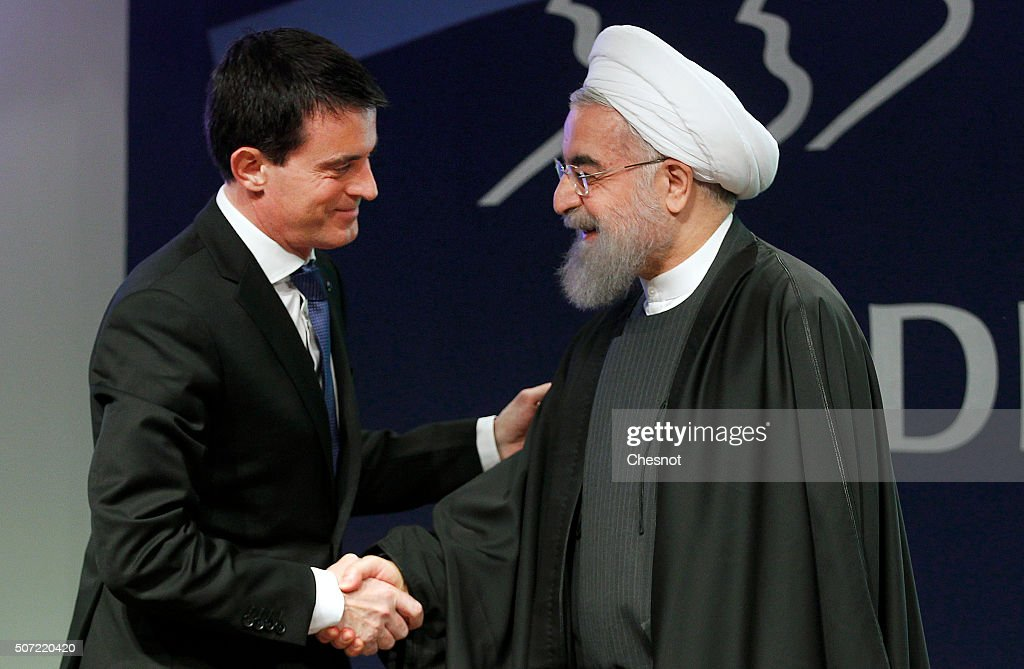 French Prime Minister <a gi-track='captionPersonalityLinkClicked' href=/galleries/search?phrase=Manuel+Valls&family=editorial&specificpeople=2178864 ng-click='$event.stopPropagation()'>Manuel Valls</a> (L) shakes hands with Iranian President Hassan Rouhani after a meeting at the French employers association MEDEF headquarters on January 28, 2016 in Paris, France. Hassan Rouhani is on the first state visit to France by an Iranian president in nearly two decades following the lifting of sanctions against his country.