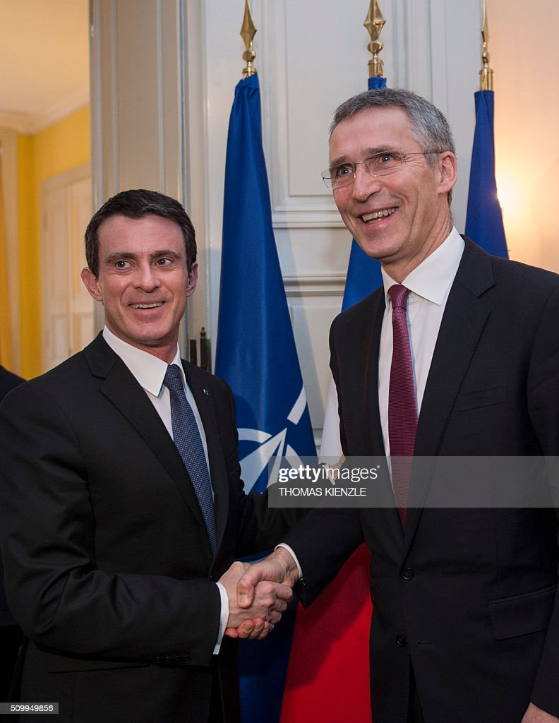 French Prime Minister Manuel Valls (L) shakes hands with NATO Secretary General Jens Stoltenberg for talks at the 52nd Munich Security Conference (MSC) in Munich, southern Germany, on February 13, 2016. / AFP / THOMAS KIENZLE