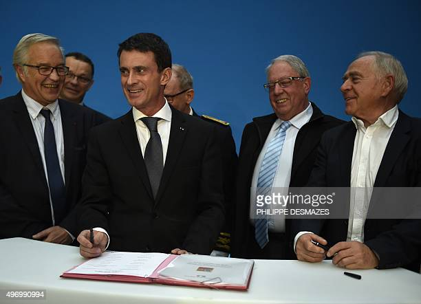 French Prime Minister Manuel Valls signs the revitalization contract of the BA 102 DijonLongvic airbase on November 13 2015 in Dijon centraleastern...