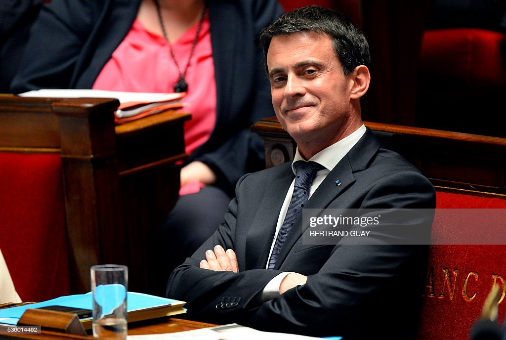 French Prime Minister Manuel Valls smiles as he attends a session of questions to the Government at the French National Assembly in Paris, on May 31, 2016.