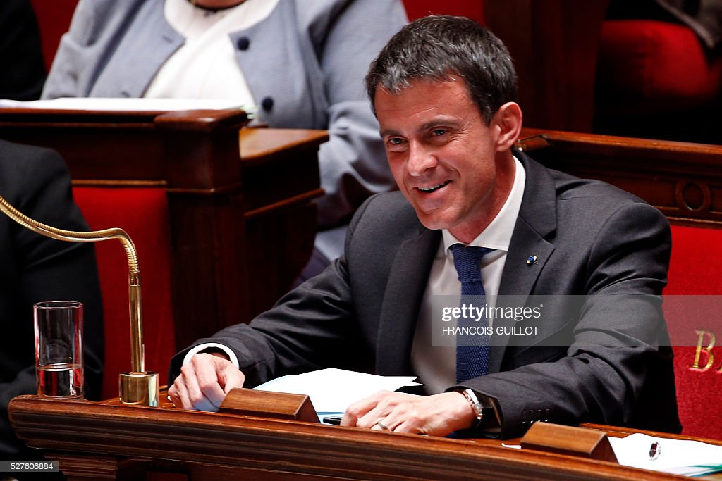 French Prime minister Manuel Valls smiles during a session of Questions to the government, on May 3, 2016 at the French National assembly in Paris.